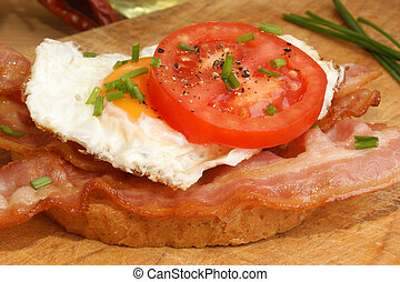 grilled organic bacon on toast and tomato