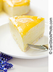 Lemon Mousse Cake - Lemon Mousse topped with a fresh and...