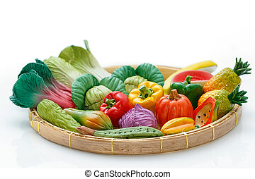 Variety of miniature clay vegetables in basket