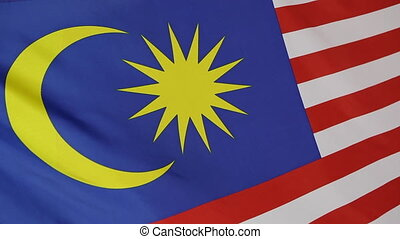 Closeup of Malaysian national flag in a slow motion