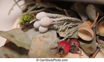 Vintage decorations: dried leaves, acorns and keys in a box...