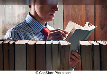 men reading a book next to the bookshelf