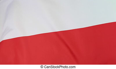 Closeup of a Polish national flag moving in the wind