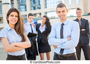 Young Business Partners - A young and pretty businesswoman...