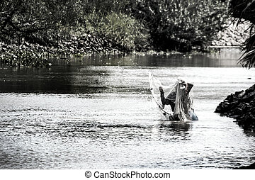 fisherman trow net in river for meal -...