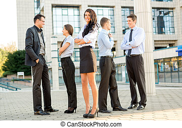 Young Business Team - Cute young businesswoman with her team...