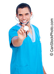 Self-assured male doctor wearing blue uniform holding a stethoscope against white background