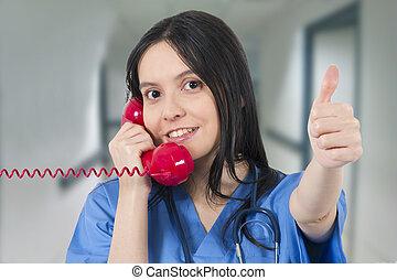 doctor talking on the landline