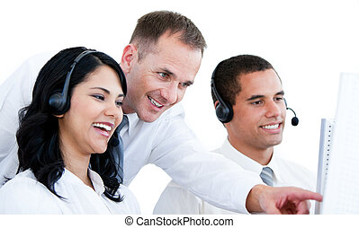 Smiling business team working on the computer against white...