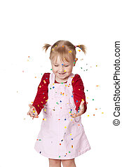 happy little girl with confetti