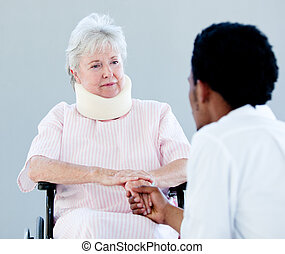 Smiling senior woman talking with a doctor in the hospital