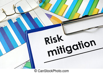 Paper with words Risk mitigation and charts