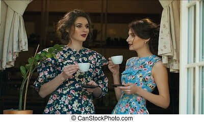 Two Old fashioned woman drink tea and talking - Two talktive...