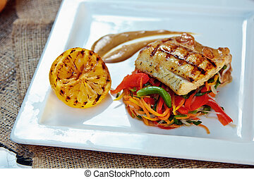 Baked perch fillet with rosemary and lemon with blanched...