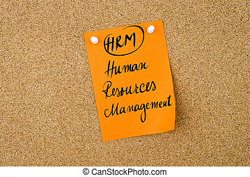 Business Acronym HRM Human Resources Management written on...