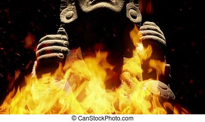 Ancient Mayan Figure In Flames - Mayan carved stone statue...