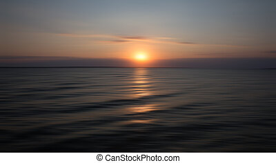 Sunset on sea with water reflection