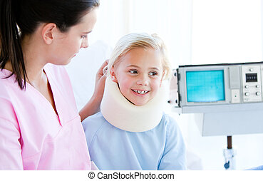 Little girl with a neck brace in a hospital