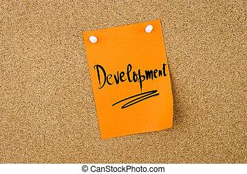 Development written on paper note