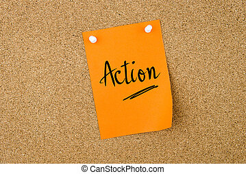 Action written on paper note