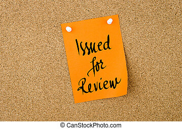 Issued For Review written on orange paper note
