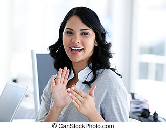 Attractive businesswoman applauding in the office