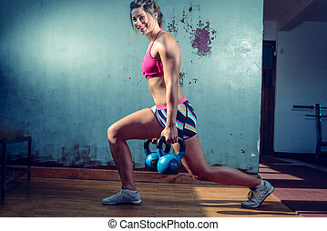 Girl doing lunge exercise - Young adult caucasian girl doing...