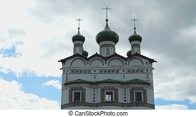 Green domes with crosses of an Orthodox monastery on the...