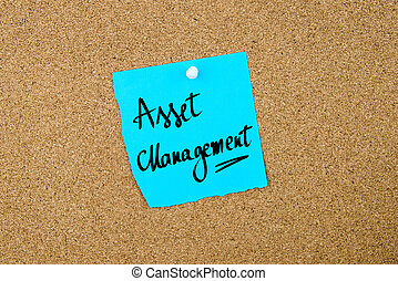 Asset Management written on blue paper note pinned on cork...