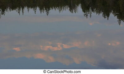 Evening sunset magic, which is reflected in slow waters of...