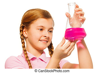 Young chemist pouring pink reagent in glass retort - Young...