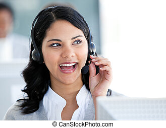 Beautiful businesswoman talking with clients in front of her computer in the office