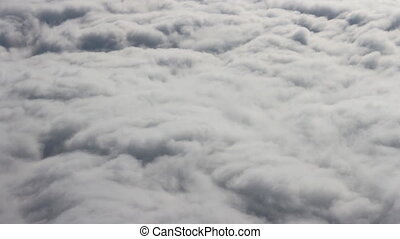 Clouds pass under wing of plane - Clouds like cotton wool...