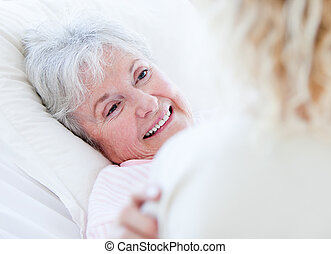 Senior woman looking at the doctor in a hospital
