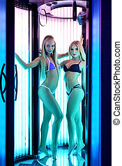 Two seductive blondes posing in tanning booth - Image of two...