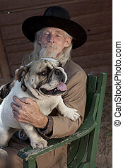 Senior Man in Western Clothing and a Dog