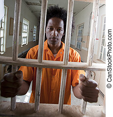 Young African American Man Behind Bars - A african american...