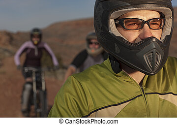 Mountain Bikers on a Desert Trail - A group of mountain...