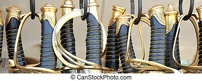 Cavalry swords. - Cavalry swords on display outdoors.