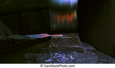 Blacksmith Forging a Knife