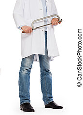 Crazy doctor is holding a big saw in his hands, isolated on...