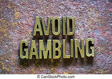 avoid gambling phrase made from metallic letters over rusty...