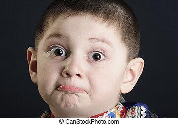 Perplexity - Little cute boy in perplexity closeup photo...