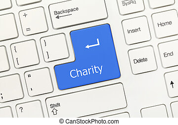 White conceptual keyboard - Charity blue key - Close-up view...