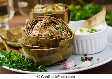 Baked artichokes cooked with garlic sauce, mustard and parsley