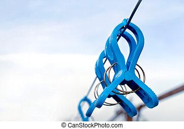 blue plastic clothespins