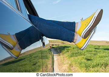 Woman legs out of the car window