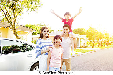 Beautiful happy family portrait  outside their  house