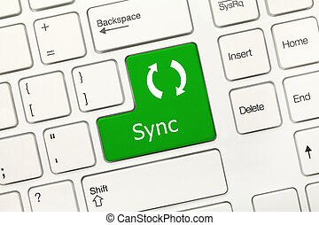 White conceptual keyboard - Sync green key - Close-up view...