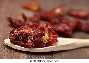 sun-dried tomatoes - closeup of some sun-dried tomatoes in a...